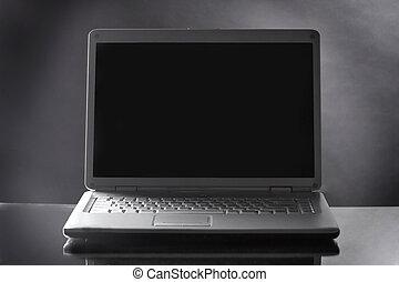 close up. opened laptop on dark background