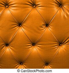 Close up orange luxury buttoned black leather