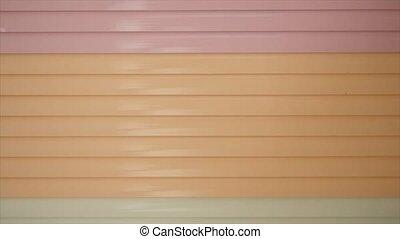 close up orange metal door shutter store.