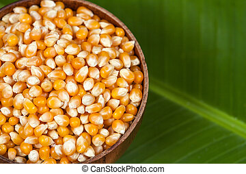 close up Organic corn seed on banana leaves background