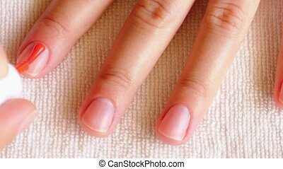 Close Up Painting Nails with Orange Color. Manicure Process.