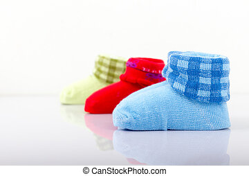 Close up pairs of colorful socks for children on white background