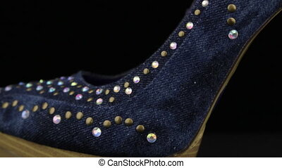Close-up. Panorama from toe to heel of denim women's high-heeled shoes. Background and texture