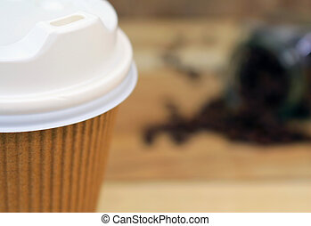 Close up paper cup of coffee with beans in bottle