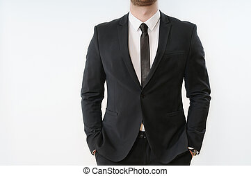 part of business man body in black suit with hands in pockets on white background