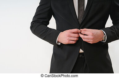 close up part of business man body side button up his black suit on white background