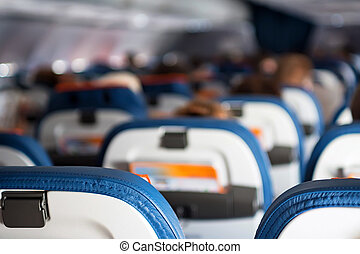 Close up passenger seats in cabin of plane