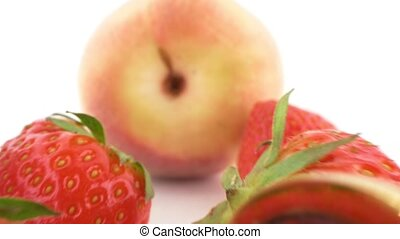 close-up. peach, strawberry and butt plug isolated on white background.