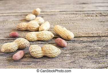 Close up peanuts on a wooden table