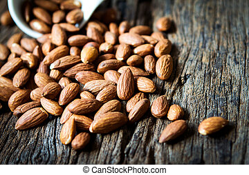 close up Peeled almonds nut on wooden background