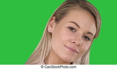 Perfect natural lip makeup Beautiful female blonde woman on a Green Screen, Chroma Key.