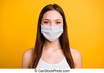 Close up photo beautiful amazing she her lady listening covid-19 news, novelty stay home wear medical mask casual white tank-top isolated bright yellow background