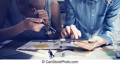 Close up photo Girl Touching Screen Digital Tablet Hand. Project Producers Researching Process. Young Business Crew Working New Startup modern Studio. Analyze market stock. Blurred, flare effect Horizontal