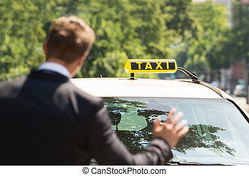 Businessman Calling Taxi