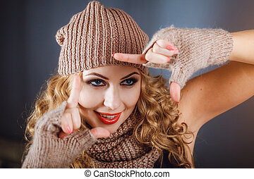 Close-up photo of a girl in a winter hat