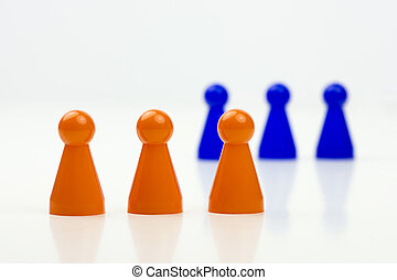 Close-up photo of a group of different-colored pieces in different positions on a white background