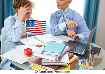 close-up photo of apple and usa flag on table