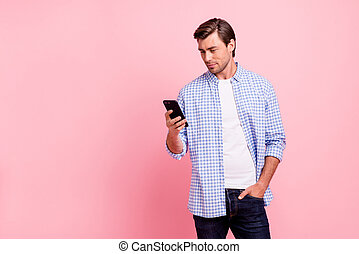 Close up photo of beautiful amazing brunet he him his handsome hold telephone writing reader love letter to foreign girlfriend wearing casual checkered plaid shirt outfit isolated on rose background