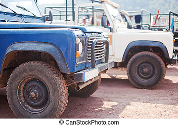 Close-up photo of blue old suv at the off-road
