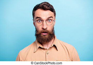 Close up photo of charming man looking wearing brown shirt isolated over blue background