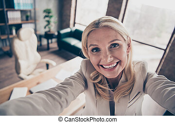 Close up photo of cheerful excited middle aged entrepreneur career woman take selfie video call online briefing with her partners clients investors in company loft workstation