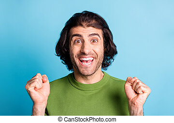 Close up photo of cheerful man two fist up celebrate open mouth nice pullover isolated on blue color background