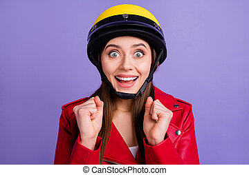 Close up photo of crazy positive cheerful girl raise fists cant wait incredible motorbike extreme journey wear biker outfit isolated over violet color background
