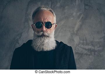 Close up photo of dreamy harsh masculine man staring with eyewear eyeglasses wearing black coat jacket isolated over gray background
