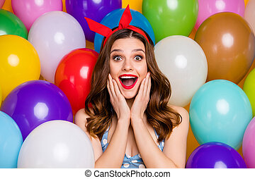 Close up photo of excited crazy girl celebrate occasion festive event astonished scream wow omg touch hands cheeks wear blue polka-dot singlet over air balls baloons background