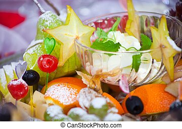 festive dish with fruit, cheese and sauce