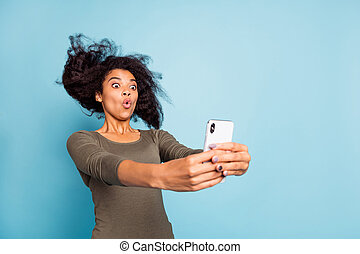 Close up photo of funny funky afro american girl feel impressed expression imagine she on roller coaster take selfie for blog blogger influencer wear style outfit isolated blue color background