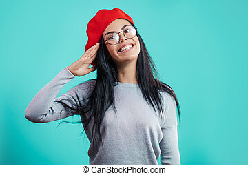 close up photo of funny girl in red beret pretending a soldier
