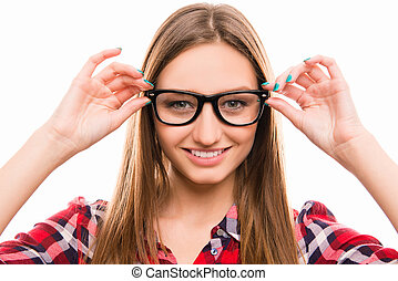Close up photo of girl touching her glasses