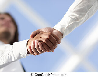 Close-up photo of handshake of two successful businessmen -...