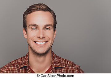 Close up photo of happy young man with beaming smile