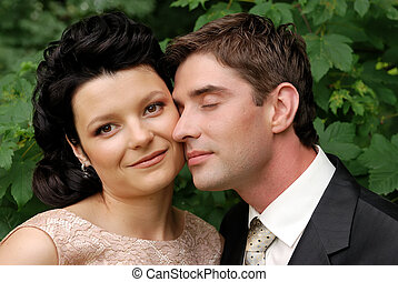 Close-up photo of happy young wedding couple