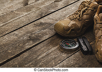 Close up photo of hiking boots and utility knife