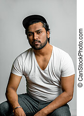 close up photo of Hindu muscular man in fashion clothes