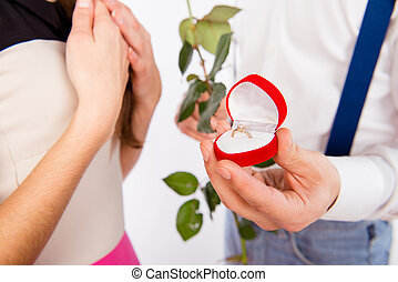 Close up photo of man making proposal of marrige with beautiful ring