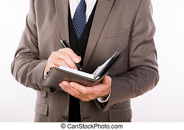 Close up photo of old businessman writing in his notepad