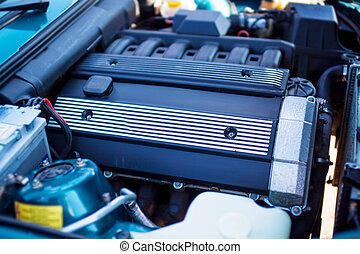 Close-up photo of old motor with intake manifold