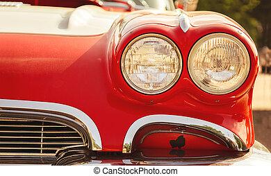 Close-up photo of retro a car headlights