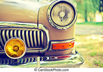 Close-up photo of retro car headlights