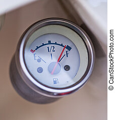 Close-up photo of retro scooter fuel gauge