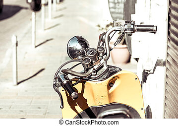 Close up photo of retro scooter in the city.