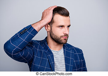 Close up photo of serious confident man applying, balm on his hair to look better with bristle on unshaven face isolated grey color background