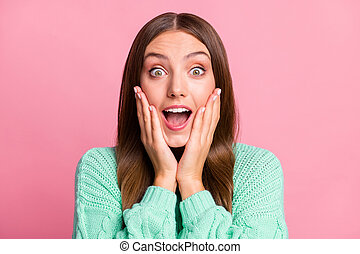 Close up photo of shocked young lady arms on cheeks open mouth teal sweater outfit isolated on pink color background