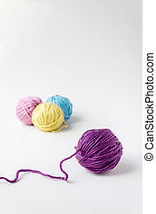 Close up photo of violet woolen ball.