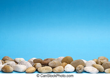 Close up photo of white and yellow stones