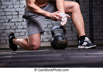 Close-up photo of young athlete man getting ready for ...